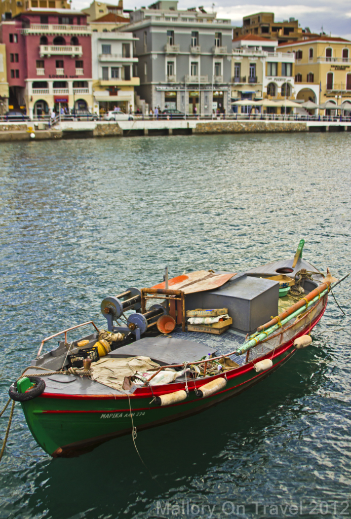 Fishing boat moored in the inner harbour at Agios Nikolaos on the Greek island of Crete on Mallory on Travel adventure photography