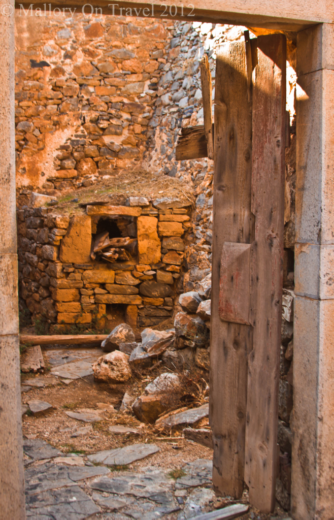 The doorways on the leper island of Spinalonga near Elouda, Crete in Greece on Mallory on Travel adventure photography