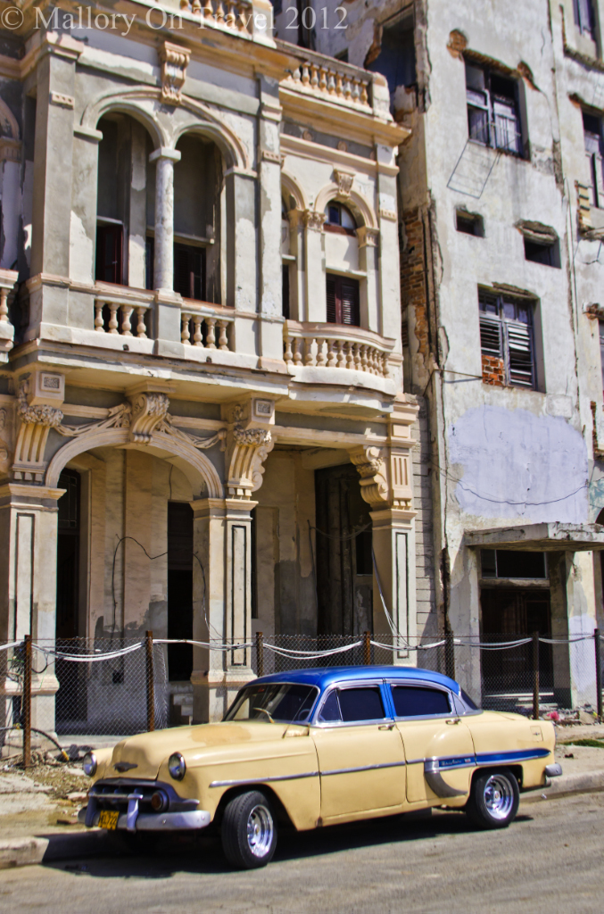 Classic car and elapidated buildings symbols of Havana, Cuba in the Caribbean  on Mallory on Travel adventure photography
