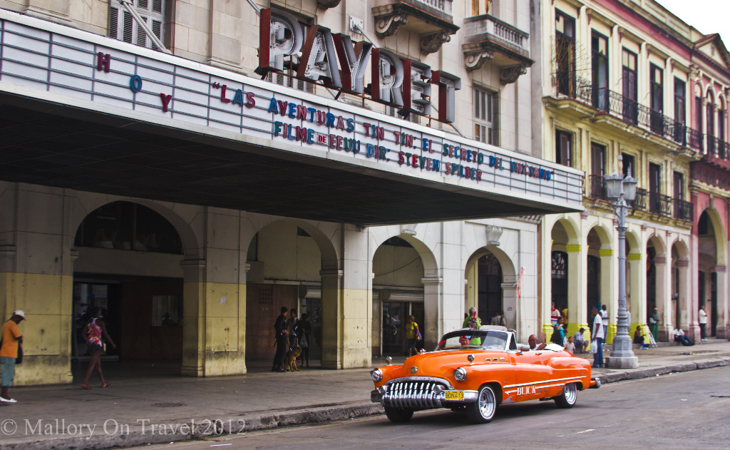 A cinema and classic car in Old Havana the capital city of the Caribbean island of Cuba on Mallory on Travel adventure photography Iain Mallory-300-6