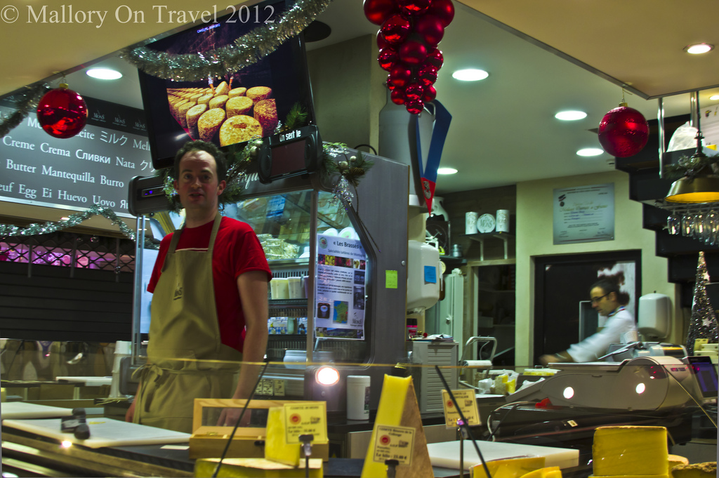 Matt the cheese seller in Lyon Hall market in the Rhone-Alpes region of France on Mallory on Travel adventure photography Iain Mallory-300-57