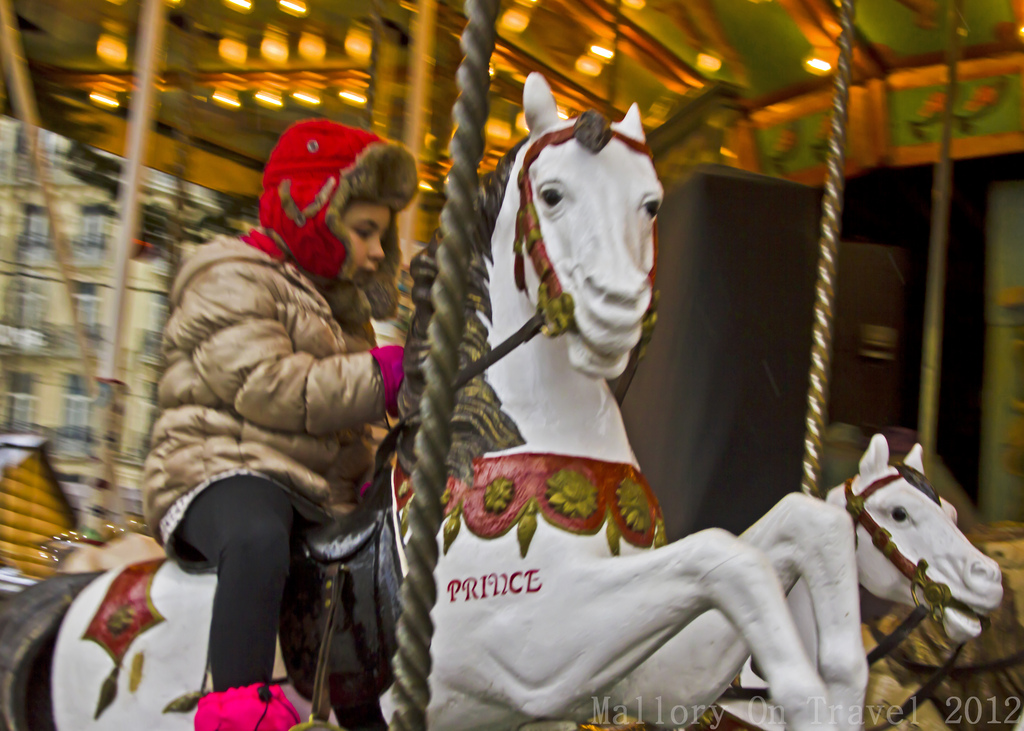 Riding the Christmas carousel in Grenoble in the Rhône-Alpes region of France on Mallory on Travel, adventure, photography Iain Mallory-300-71