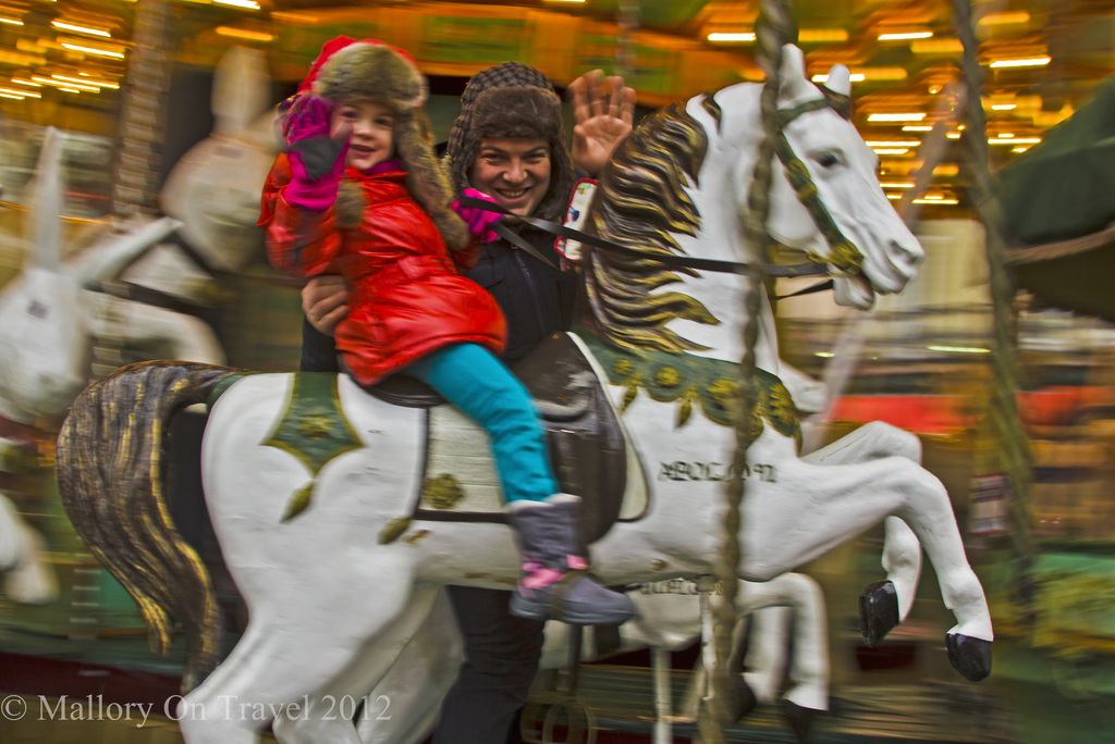 Riding the Christmas carousel in Grenoble in the Rhône-Alpes region of France on Mallory on Travel, adventure, photography Iain Mallory-300-70
