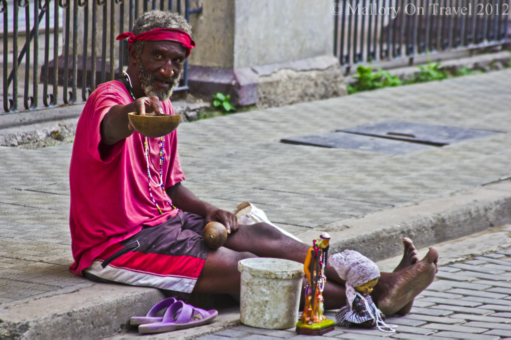 A beggar on the streets of Old Havana on the Caribbean island of Cuba on Mallory on Travel, adventure, photography Iain Mallory-300-109
