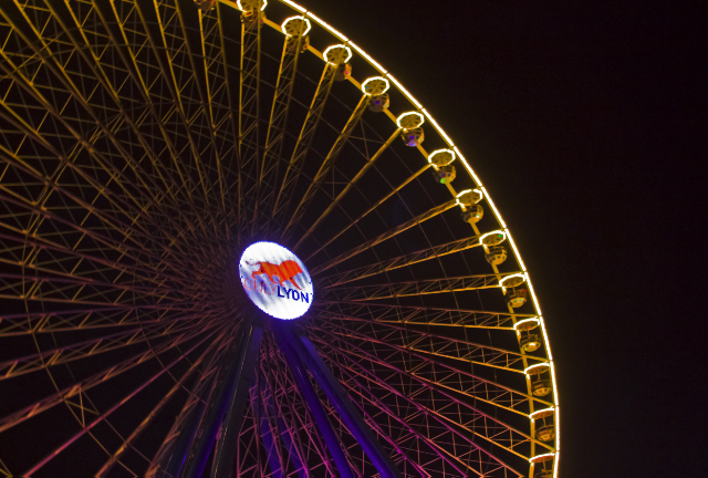 The large ferris wheel in the Lyon Festival of Light in the Rhône Valley, France on Mallory on Travel adventure photography