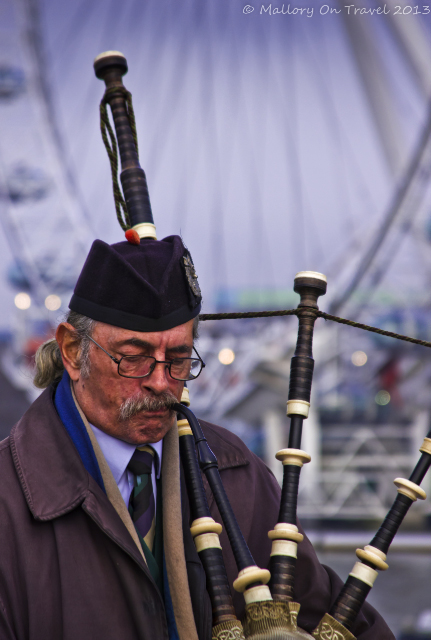 A busker playing the bagpipes on the Westminster Bridge, London in Great Britain  on Mallory on Travel, adventure, adventure travel, photography Iain Mallory-300-61 street-performer