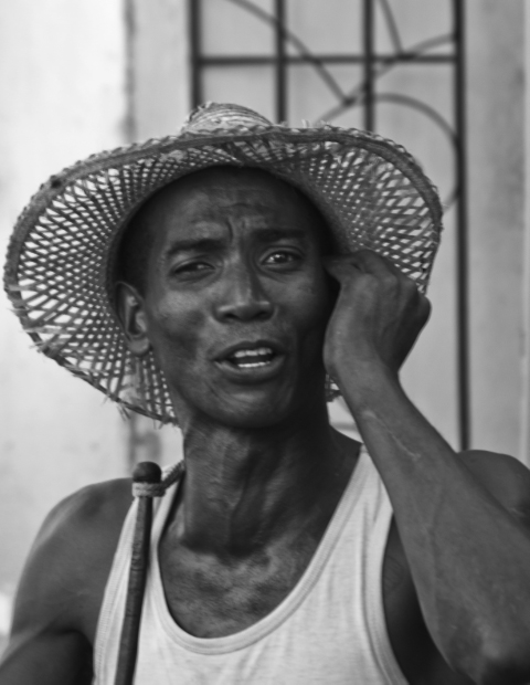 Cuban plantation worker in Trinidad on the Caribbean island of Cuba on Mallory on Travel, adventure, adventure travel, photography Iain Mallory-300-219BW cuban_man.jpg