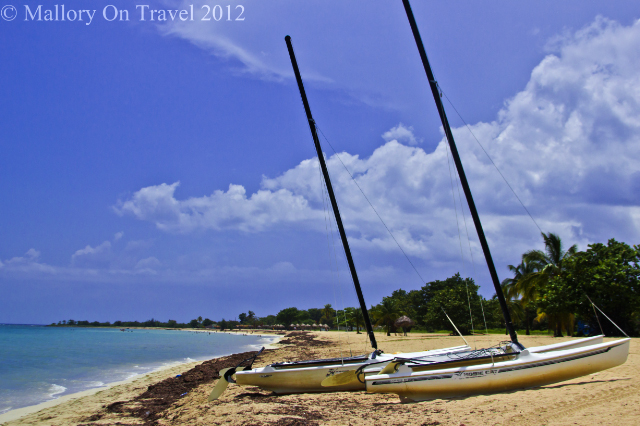 Travelling vicariously; sailing catamarrans on a beach near Trindad on the island of Cuba in the Caribbean on Mallory on Travel, adventure, adventure travel, photography Iain Mallory-300-29 beach_paradise