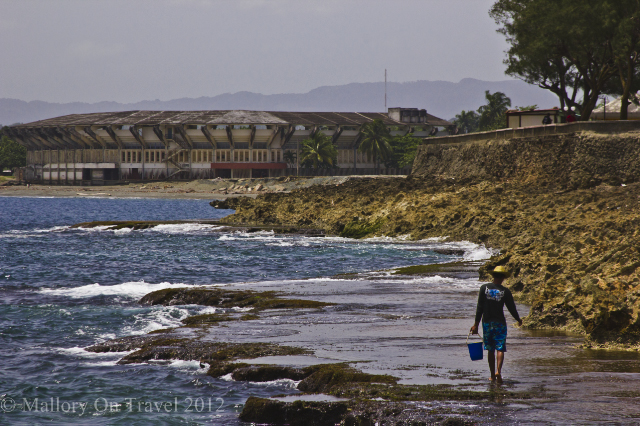 Lone fisherman with the baseball stadium as a backdrop in Baracoa on the Caribbean island of Cuba on Mallory on Travel, adventure, adventure travel, photography Iain Mallory-307-1 baracoa_cuba.jpg