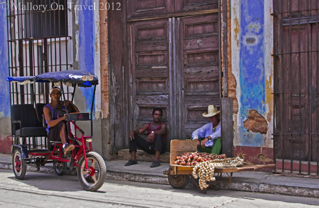 A typical street scene greeting travellers in Trinidad on the Caribbean island of Cuba on Mallory on Travel, adventure, adventure travel, photography on Mallory on Travel, adventure, adventure travel, photography Iain Mallory-300-61 cuban_men