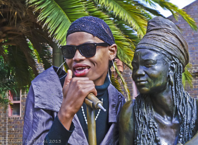 A capella singer at the Brenda Fassie sculpture in cultural precinct of Newtown, Johannesburg, South Africa on Mallory on Travel, adventure, adventure travel, photography on Mallory on Travel, adventure, adventure travel, photography Iain Mallory-300-19