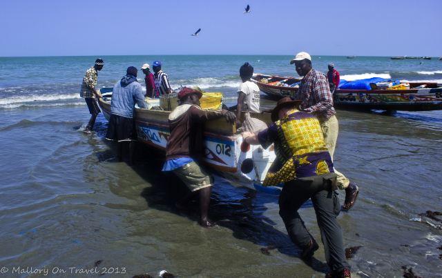 Pushing a pirogue at Tanji market in The Gambia, Africa on Mallory on Travel, adventure, adventure travel, photography Iain Mallory-300-22