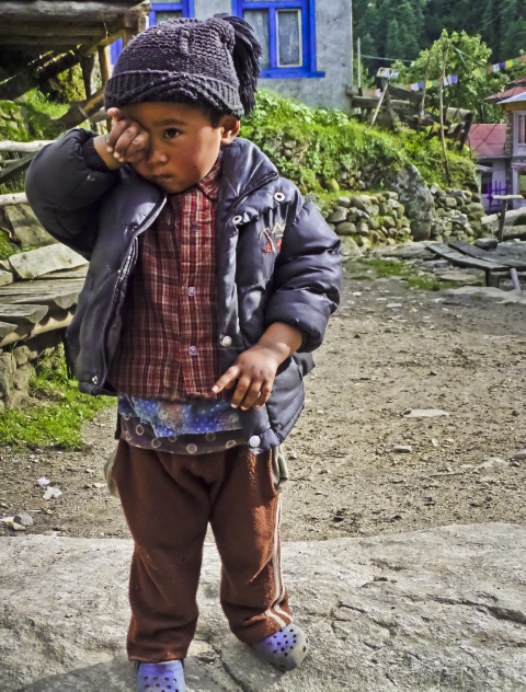 Child of Nepal in Phanding in the Khumbu region on the Everest base camp route on Mallory on Travel, adventure, adventure travel, photography