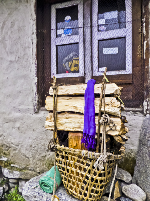 Treks to Nepal; A basket of firewood waiting for a Sherpa porter on the Everest Base Camp trail in the Himalaya on Mallory on Travel, adventure, adventure travel, photography