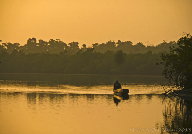 Photographs of Africa; Fisherman returning home, passing Mandina Lodges in the Makasutu Forest in The Gambia on Mallory on Travel, adventure, adventure travel, photography Iain Mallory-300-2