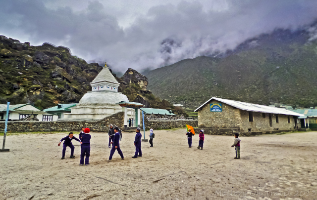 School children playing in Khumjung village Nepal in the Khumbu region on the Everest base camp route on Mallory on Travel, adventure, adventure travel, photography