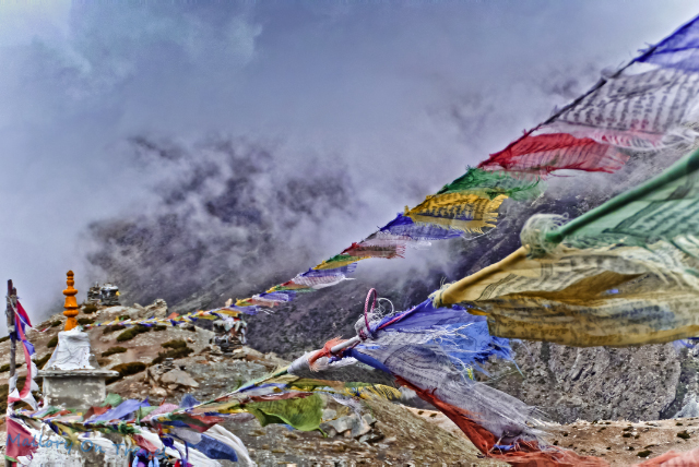 Trekking in Nepal; Tibetan prayer flags above the village of Dingboche in Khumbu region of the Himalaya on Mallory on Travel, adventure, adventure travel, photography