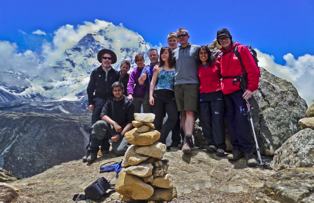 Trekking in Nepal; Everest Base Camp trekkers posing in front of Ama Dablam in the Khumbu region of the Himalaya on Mallory on Travel, adventure, adventure travel, photography