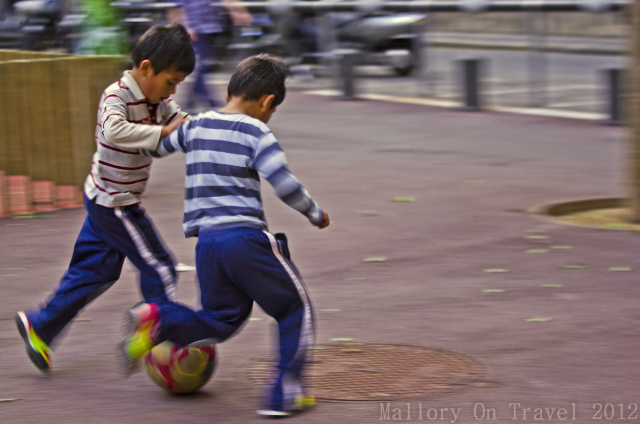 Young players on the streets of Barcelona dreaming of playing for the Catalan superstars on Mallory on Travel adventure, adventure travel, photography Iain Mallory-300-6