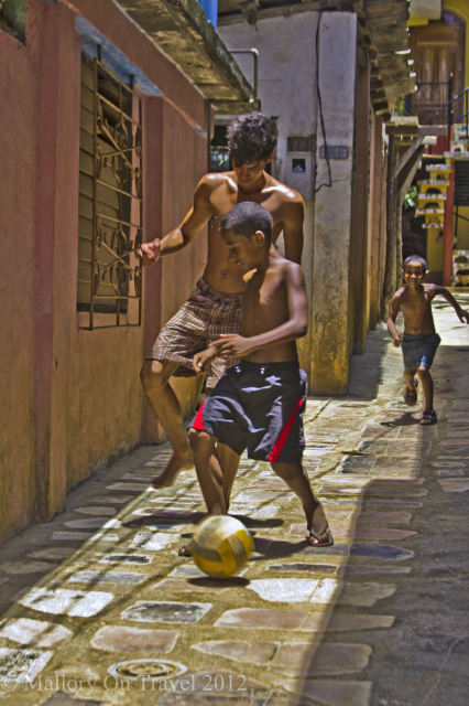 Football stars in the backstreets of Baracoa on the the Caribbean island of Cuba on Mallory on Travel adventure, adventure travel, photography Iain Mallory-300-78