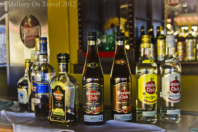 Budget travel tips, Havana Club in a bar in Baracoa, Cuba in the Caribbean on Mallory on Travel adventure, adventure travel, photography Iain Mallory-300-207_havana_club