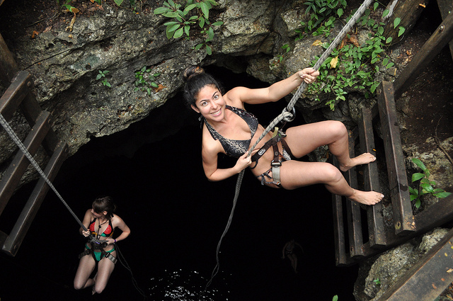 Maria Laborde of LatinAbroad abseiling a Mexico cenote on Mallory on Travel adventure, adventure travel, photography