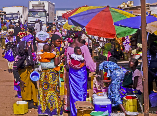 Colourful women shopping at a fish market in the Gambia on Mallory on Travel adventure, adventure travel, photography Iain Mallory-300-39 market_gambia