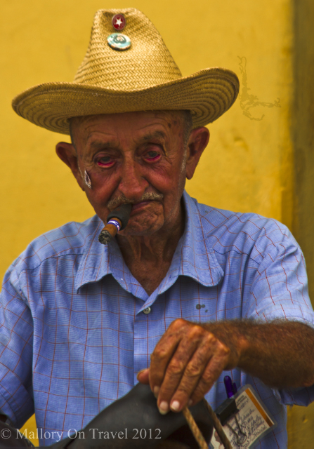 People photography; Cuban local enjoying his cigar in Trinidad on the Caribbean island of Cuba on Mallory on Travel adventure, adventure travel, photography Iain Mallory-300-62-1 cuban_smoker