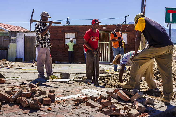 Workmen in in the township of Masiphumelele near Cape Town, South Africa on Mallory on Travel adventure, adventure travel, photography Iain Mallory-300-12 masiphumelele-workmen