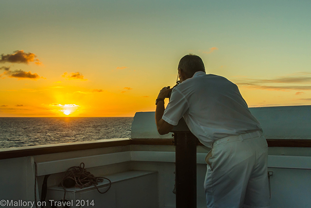 Chief officer of RMS St Helena takies a sunset bearing in the the South Atlantic on Mallory on Travel adventure, adventure travel, photography Iain Mallory-300-15 rms_sthelena
