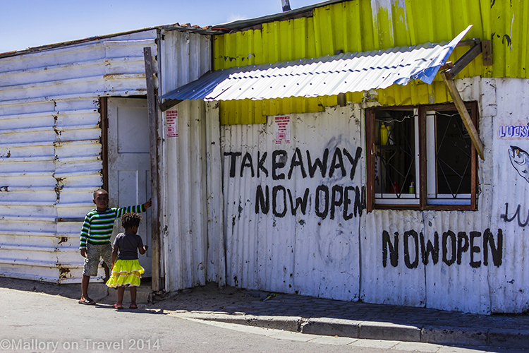 Takeaway restaurant in the township of Masiphumelele  near Cape Town, South Africa on Mallory on Travel adventure, adventure travel, photography Iain Mallory-300-80 southafrica_township