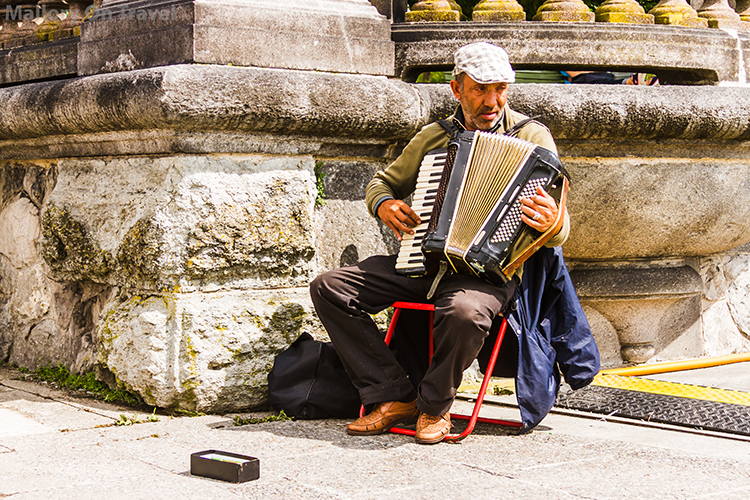 Accordion playing street performer in Zurich, Switzerland  on Mallory on Travel adventure, adventure travel, photographyIain Mallory-300-3 zurich_busker