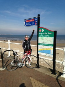 Alison Bailey finishing the coast to coast bike ride on Mallory on Travel adventure, adventure travel, photography