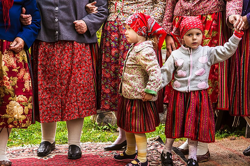 Young girls dancing on the island of Kihnu, in Estonia of the Baltic States on Mallory on Travel adventure, adventure travel, photography Iain_Mallory_1402834 kihnu_girls