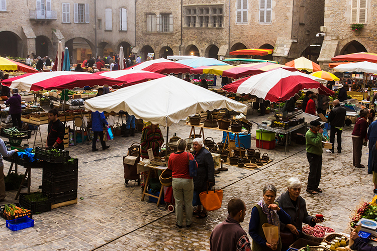 The markets of Villefrance-de-Rouergue in Place Notre Dame in the Aveyron region of  France on Mallory on Travel adventure, adventure travel, photography Iain_Mallory_Ave1403173 villefrance_de_rouergue