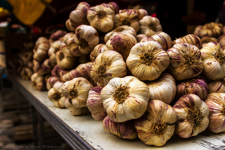 Garlic on the markets of Villefrance-de-Rouergue in Place Notre Dame in the Aveyron region of France on Mallory on Travel adventure, adventure travel, photography Iain_Mallory_Ave1403193 villefrance_de_rouergue