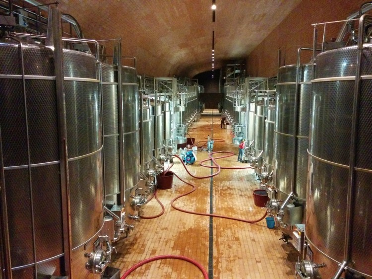 Photograph of wine vats in a cellar in a Tuscan vineyard, Italy taken on a Google Nexus 5 smartphone using the standard Android app, and edited with the included software, suitable for posting to social media like Twitter, Facebook or Instagram on Mallory on Travel adventure, adventure travel, photography