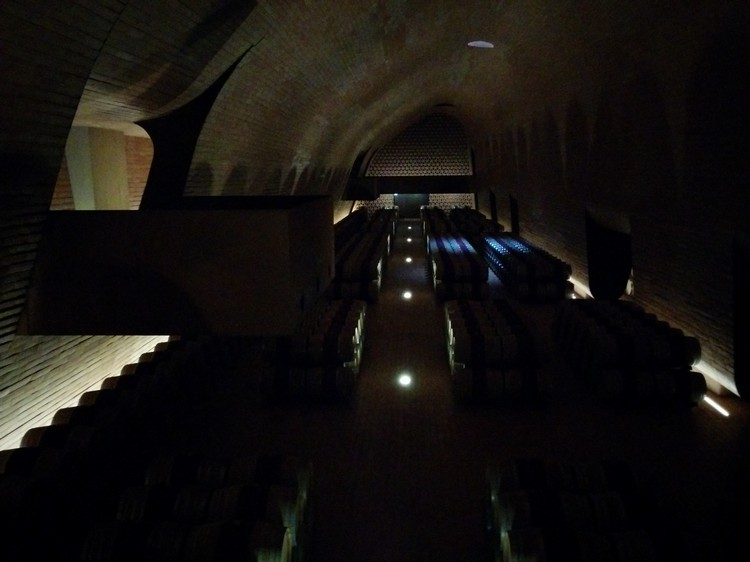 Photograph of a winery cellar in a Tuscan vineyard, Italy taken on a Google Nexus 5 smartphone using the standard Android app, and edited with the included software, suitable for posting to social media like Twitter, Facebook or Instagram on Mallory on Travel adventure, adventure travel, photography