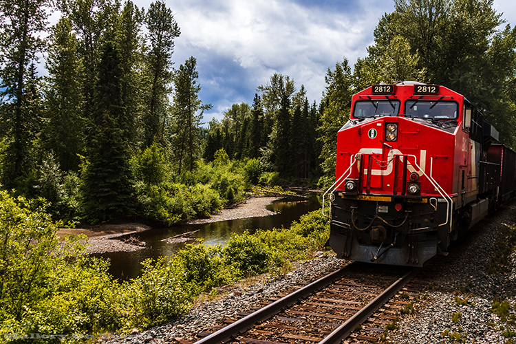 Travel experiences: A cargo train seen travelling across Canada from Nova Scotia to British Columbia with Via  Rail  on Mallory on Travel adventure, adventure travel, photography Iain Mallory-53 canadian_rail