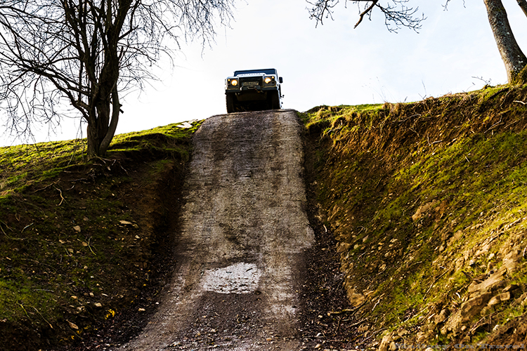 Driving a Landrover Defender 110 down a 45 degree incline on a LandRover Experience Day at Eastnor Castle near Ledbury in the Malvern Hills on Mallory on Travel adventure, adventure travel, photography Iain_Mallory_LR1407935 landrover_experience