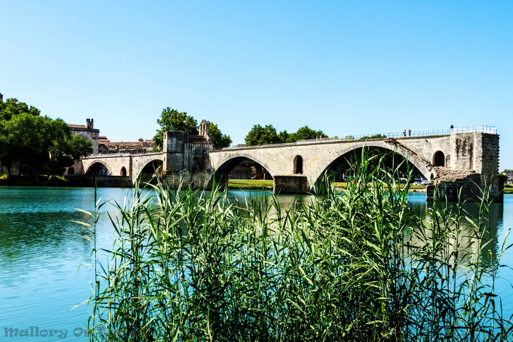 The famous half bridge in Avignon, Pont Saint-Benezet on the Rhone river in Provence region in the South of France on Mallory on Travel adventure, adventure travel, photography Iain_Mallory_Rhone1412248