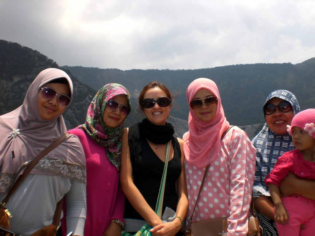 Claudia and new Indonesian friends at Tangkuban Perahu volcanic crater Indonesia on Mallory on Travel adventure travel, photography, travel