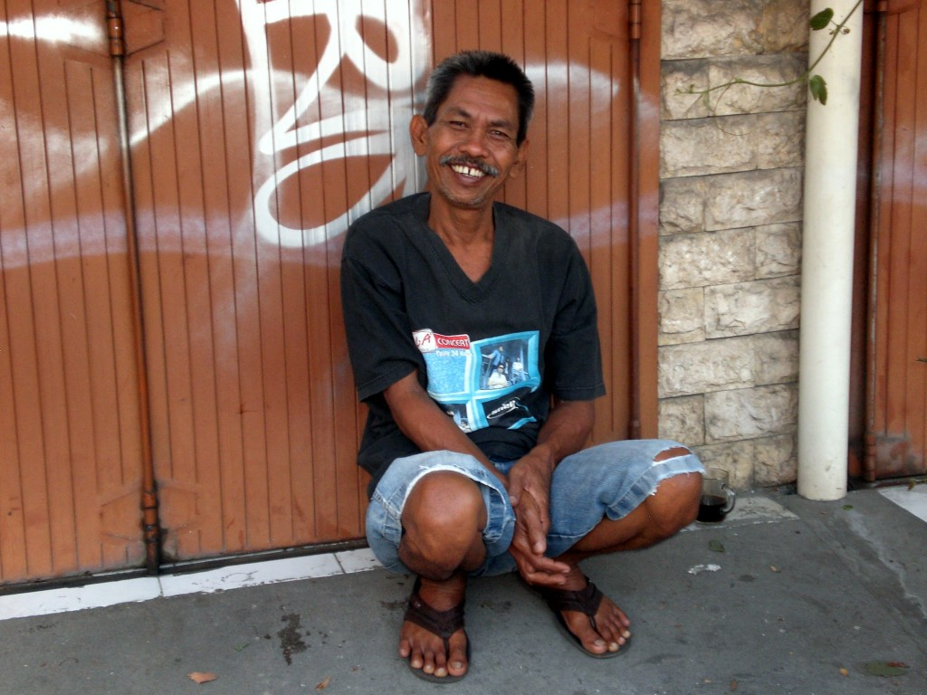Smiling man in Indonesia on Mallory on Travel adventure travel, photography, travel