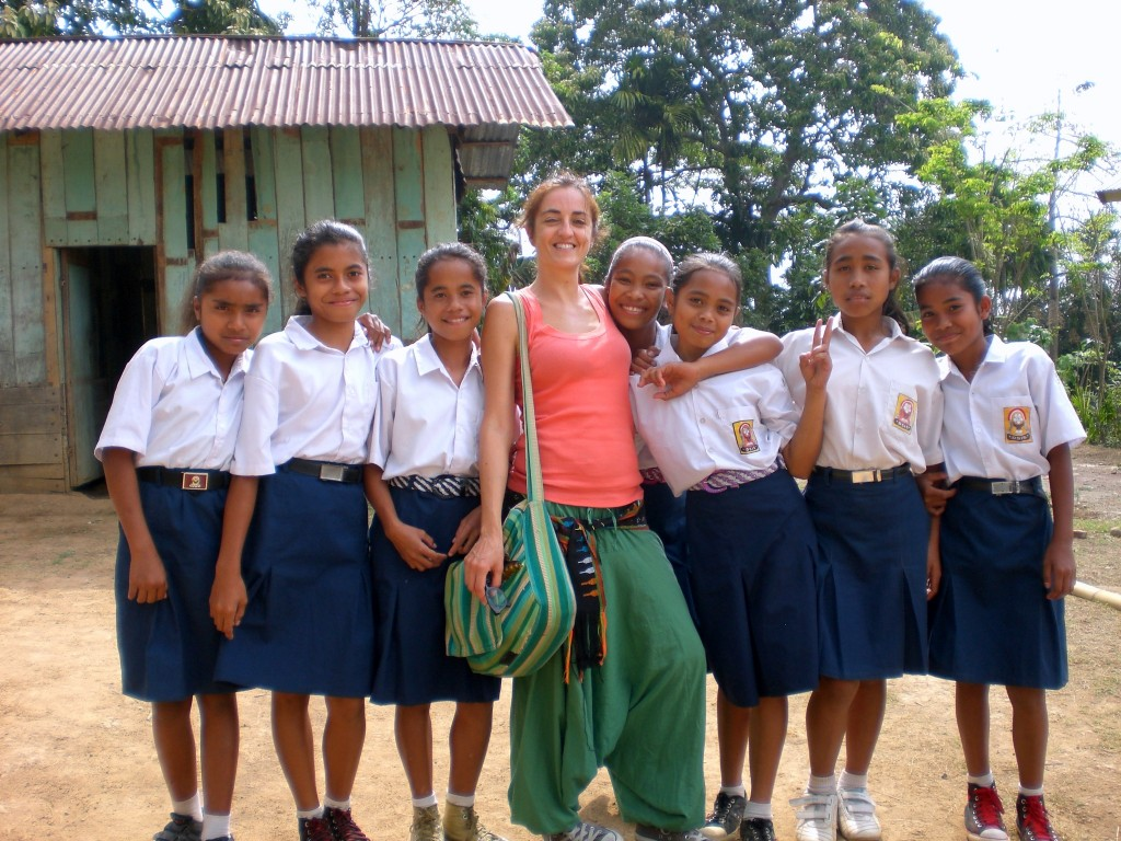 Claudia Tavani with children at the Taman Bacaan Pelangi school in the village of Melo, Komodo Islands, Indonesia on Mallory on Travel adventure travel, photography, travel