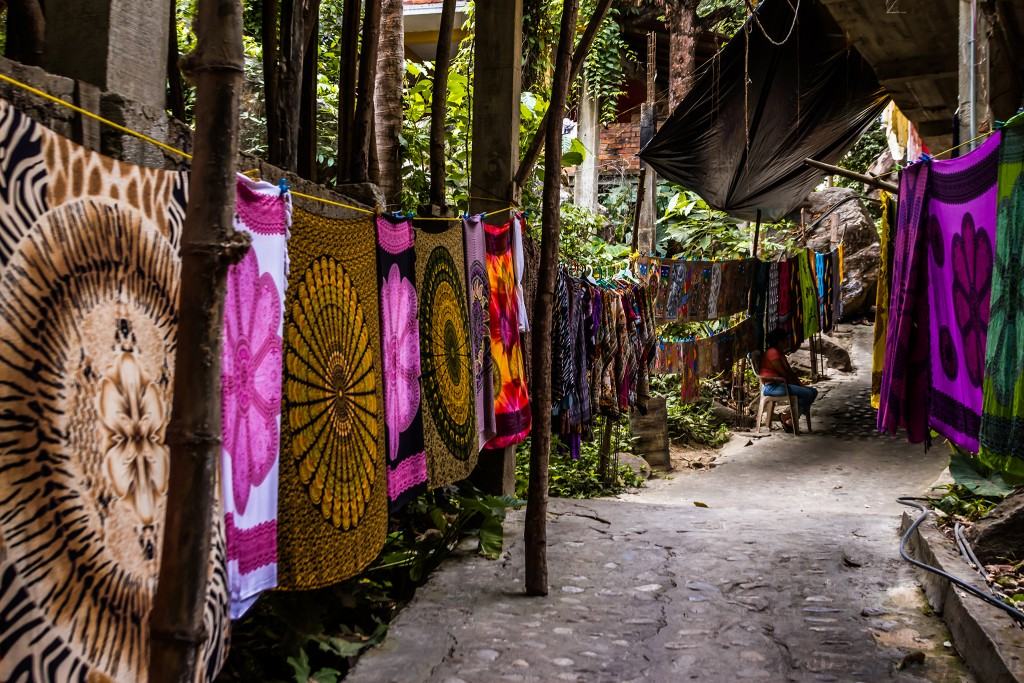 Colourful fabrics on sale in the village of Quimixto, Jalisco near Puerto Vallarta on the Pacific coast of Mexico on Mallory on Travel adventure travel, photography, travel Iain_Mallory_Mex1411093