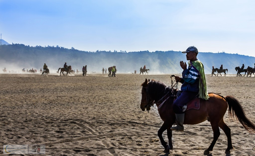 Horse wrangler on the Sea of Sand plain at Mount Bromo an active volcano in the Tennger massif in East Java, Indonesia on Mallory on Travel adventure travel, photography, travel Iain_Mallory_Indo15662