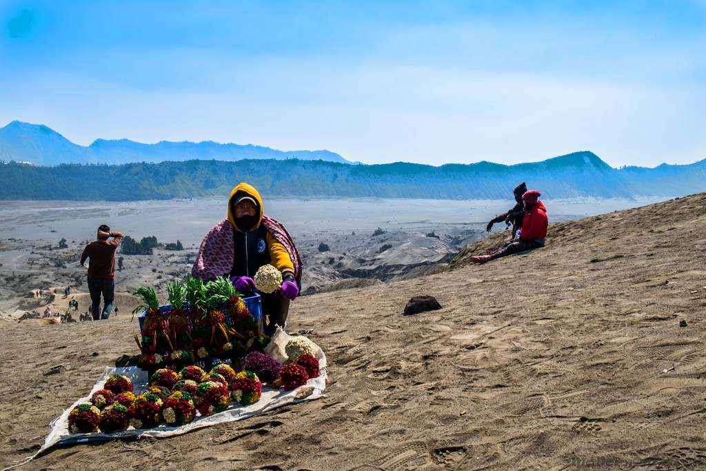 Merchant at Mount Bromo under cloud cover, an active volcano rising from the Sea of Sands in the Tennger massif in East Java, Indonesia on Mallory on Travel adventure travel, photography, travel Iain_Mallory_Indo8246