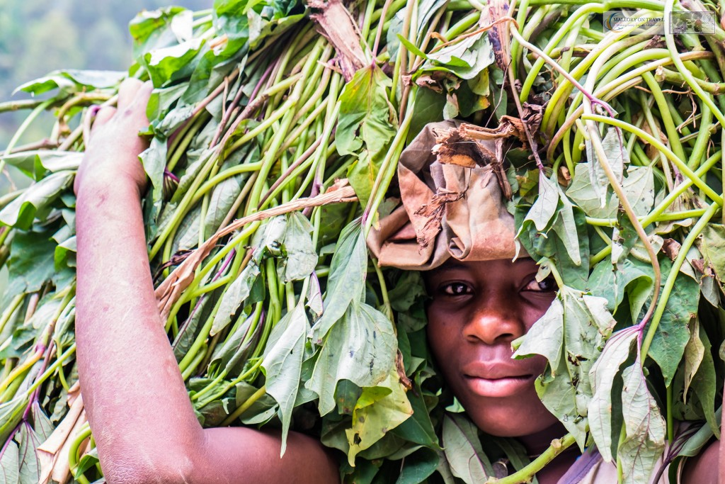 Young Rwandan girl carrying vegetables on her head on the road to Kigali in Rwanda, east Africa on Mallory on Travel adventure travel, photography, travel Iain_Mallory_Rwanda-1899