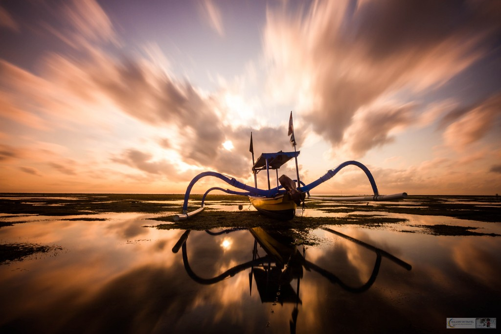 An outrigger boat under dynamic skies at sunrise on Sanur Beach, Ubud in Bali, Indonesia on Mallory on Travel adventure travel, photography, travel Iain Mallory_Bali_1389