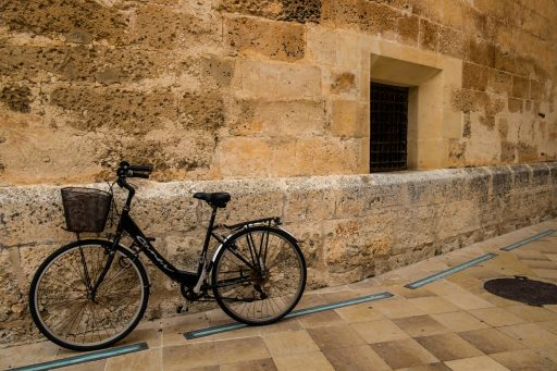 A bicycle in the main square of old Ciutadella, Menorca, Spanish Balearic island in the Mediterranean on Mallory on Travel adventure travel, photography, travel Iain_Mallory_Menorca-3098